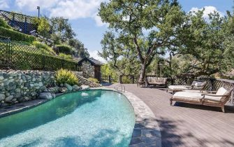 BGUK_2187625 - Los Angeles, CA  - Brooke Shields lists luxury Pacific Palisades, CA home for just over $8 million. Shields spends most of her time in New York nowadays, so the Manhattan native has finally decided to bid her longtime West Coast residential outpost goodbye. Married since 2001 to writer-producer Chris Henchy, the child model turned actress paid $3.3 million for the Pacific Palisades home - a rustic chalet-style residence in the ritzy Riviera neighborhood - more than two decades ago, when she was newly wed to former pro tennis star Andre Agassi. On and off the rental market for the past several years — once for as much as $35,000 per month, fully furnished — the house was supposedly occupied by former couple Ben Affleck and Jennifer Garner years ago, while the couple was renovating their sprawling compound just a few doors away. Resting atop a secluded parcel of land with splendid canyon and mountain views, the cedar-shingled house, listed for $8.195 million,  was built in 1982. Included are five bedrooms and 5.5 bathrooms spread across 5,300 sq ft of living space. There are three full floors, all of them replete with shabby chic-style interiors; dark-stained Douglas fir hardwood floors and whitewashed beamed ceilings provide contrast. Street-parked guests must bypass the gated driveway and brick motor court to reach the house, which welcomes with a double-height foyer connected to a massive living room. A fireplace and wall of glass doors leads to a wraparound terrace. Also on the main level are a formal dining room and a fully updated chef's kitchen expensively outfitted with a marble-topped eat-in island and top-of-the-line stainless appliances. The penthouse-style master suite encompasses the home's entire top floor and comes complete with an office/study, a fireplace-equipped bedroom, separate sitting room and a balcony with views out toward the Getty museum. There's also a spa-inspired bath decked out with yet another fireplace, a makeup vanity, s