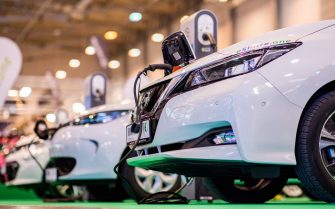 30 November 2018, North Rhine-Westphalia, Essen: Several Nissan Leaf electric cars are exhibited at the Tuning Fair Essen Motor Show. The fair will take place until 9.12.. Photo: Marcel Kusch/dpa