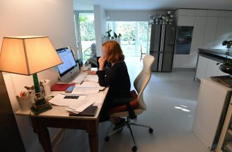Simona Pozzi, Co-Head of Retail Hub of Equita Company, Italy,at work in her living room, Milan, Italy,19 October 2020. Due to the coronavirus epidemic and to contain the risk of contagion, many companies have still forced their employees not to show up for work and, for those authorized, to resort to smartworking. ANSA / DANIEL DAL ZENNARO