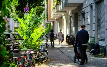 24 August 2021, Berlin: A man pushes a baby carriage along a street in the Neukölln district. Photo: Stefan Jaitner/dpa (Photo by Stefan Jaitner/picture alliance via Getty Images)