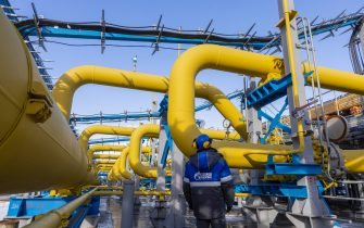 A worker checks the pressure gauge on pipework at the Comprehensive Gas Treatment Unit No.3 of the Gazprom PJSC Chayandinskoye oil, gas and condensate field, a resource base for the Power of Siberia gas pipeline, in the Lensk district of the Sakha Republic, Russia, on Monday, Oct. 11, 2021. Amid record daily swings of as much as 40% in European gas prices, Russian President Vladimir Putin made a calculated intervention to cool the market last week by saying Gazprom can boost supplies to help ease shortages. Photographer: Andrey Rudakov/Bloomberg
