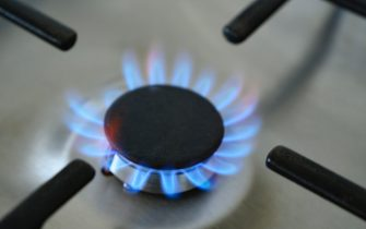 ZWOLLE, NETHERLANDS - OCTOBER 11: Blue and orange flames on a gas stove burner in a kitchen in Zwolle, Overijssel, The Netherlands on October 11. Energy prices are rising fast in The Netherlands, causing financial problems for households. (Photo by Sjoerd van der Wal/Getty Images)