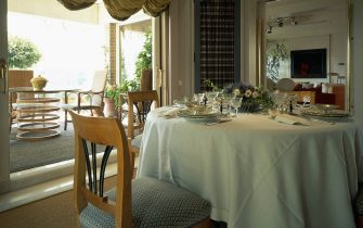View of an organized dining table. (Photo by Quick Image/Construction Photography/Avalon/Getty Images)