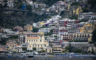 A view taken on July 1, 2020 shows the village of Positano on the Amalfi coast in southern Italy. - With its white and multicoloured houses perched on the mountainside about the crystalline waters of the Mediterranean, Italy's Amalfi coast is suffering from this year's lack of US tourists. (Photo by Filippo MONTEFORTE / AFP) (Photo by FILIPPO MONTEFORTE/AFP via Getty Images)