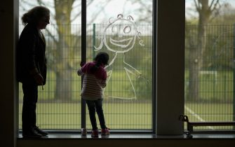 "ALTRINCHAM, ENGLAND - APRIL 08:  A young girl paints a picture of herself on the school window as children of key workers take part in school activities at Oldfield Brow Primary School on April 08, 2020 in Altrincham, England. The government announced the closure of UK schools from March 20 except for the children of key workers, such as NHS staff, and vulnerable pupils, such as those looked after by local authorities. The prime minister has said schools will remain closed ""until further notice,"" and many speculate they may not reopen until next term. (Photo by Christopher Furlong/Getty Images)"