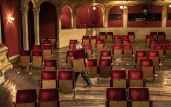 BERLIN, GERMANY - JUNE 03: An employee demonstrates removing of the chairs from the rows of seats in the auditorium of the Berliner Ensemble on June 03, 2020 in Berlin, Germany. Due to the contact restrictions during the corona pandemic, individual seats will be removed for future performances.  (Photo by Maja Hitij/Getty Images)