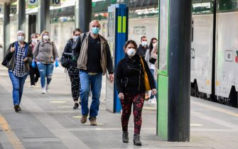 Commuters wearing a face mask arrive from regional trains at the Cardona railway station on May 4, 2020 in Milan, as Italy starts to ease its lockdown, during the country's lockdown aimed at curbing the spread of the COVID-19 infection, caused by the novel coronavirus. - Stir-crazy Italians will be free to stroll and visit relatives for the first time in nine weeks on May 4, 2020 as Europe's hardest-hit country eases back the world's longest nationwide coronavirus lockdown. (Photo by Miguel MEDINA / AFP) (Photo by MIGUEL MEDINA/AFP via Getty Images)