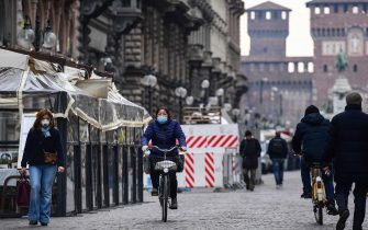 People wearing a respiratory mask go across Via Dante in downtown Milan on March 10, 2020. - Italy imposed unprecedented national restrictions on its 60 million people on March 10, 2020 to control the deadly coronavirus, as China signalled major progress in its own battle against the global epidemic. (Photo by Miguel MEDINA / AFP) (Photo by MIGUEL MEDINA/AFP via Getty Images)