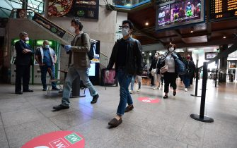 Commuters arrive from regional trains at the Cardona railway station on May 4, 2020 in Milan as Italy starts to ease its lockdown, during the country's lockdown aimed at curbing the spread of the COVID-19 infection, caused by the novel coronavirus. - Stir-crazy Italians will be free to stroll and visit relatives for the first time in nine weeks on May 4, 2020 as Europe's hardest-hit country eases back the world's longest nationwide coronavirus lockdown. (Photo by Miguel MEDINA / AFP) (Photo by MIGUEL MEDINA/AFP via Getty Images)