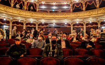 KRAKOW, POLAND - JUNE 19: Guests wear protective face masks and practice social distance as they watch the first performance inside the Juliusz Slowacki Theatre  after the coronavirus lockdown on June 19, 2020 in Krakow, Poland. Poland has been relaxing the COVID -19 restrictive measures for more than a month but the number of infections is on the rise with over 1300 deaths related to Covid-19 and more than 31,000 infections. (Photo by Omar Marques#781169#51A ED/Getty Images)