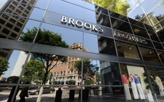 """A view of the front of the Brooks Brothers store in downtown Los Angeles on March 19, 2010. Brooks Brothers, which has been selling suits in downtown Los Angeles since 1939 and is the oldest men's clothier chain in the US, is closing, according to the Downtown News. There will be no final closeout sale and the location will have a """"quiet closing"""" on March 22, store manager Max Pierce was quoted in the Downtown News as saying.        AFP PHOTO / Robyn BECK (Photo credit should read ROBYN BECK/AFP via Getty Images)"""