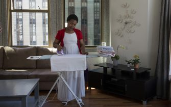 CAPE TOWN, SOUTH AFRICA NOVEMBER 22: Aisha R Pandor, the co-founder of SweepSouth inside a clients apartment while one of her domestic worker cleans the apartment on November 22, 2016 in Central Cape Town, South Africa. Many women are queuing to go through training and to work for the booming company, which has operations around South Africa, and want to expand to other African countries. (Photo by Per-Anders Pettersson/Getty Images)