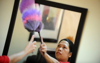 TO GO WITH AFP STORY Philippines-labour-maids-poverty,FEATURE, by Mynardo MacaraigA Filipina maid cleans a mirror during a government-mandated crash course in domestic duties in Manila on September 14, 2011.  Nearly 100,000 women in the impoverished Philippines head overseas each year to toil as maids, many of whom come from homes where washing clothes is done by hand and dishes are cleaned in a bucket.      AFP PHOTO / NOEL CELIS (Photo credit should read NOEL CELIS/AFP via Getty Images)