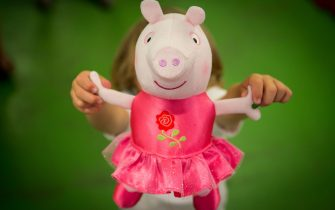 LONDON, ENGLAND - JUNE 25:  A boy holds a 'One Upon A Time Princess Rose' Peppa Pig toy at Hamleys on June 25, 2015 in London, England.  This Peppa Pig, which will sing by having its hands held, sells for £20. The Hamleys toy shop have made their predictions for the top selling toys for Christmas 2015. (Photo by Rob Stothard/Getty Images)