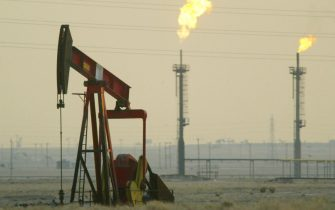 KUWAIT - JANUARY 15:  A derek pumps in a oil field January 15, 2003 near the Saudi Arabian border, Kuwait. Kuwait produces 10% of the worlds oil and has promised to increase production as needed in the event of a war in Iraq.  (Photo by Joe Raedle/Getty Images)