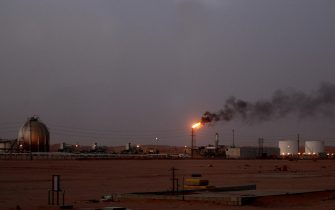 "A flame from a Saudi Aramco (the national oil company) oil installation known as ""Pump 3"" burns brightly during sunset in the Saudi Arabian desert near the oil-rich area Al-Khurais, 160 kms east of the capital Riyadh, on June 23, 2008. Deep in the Saudi desert, 28,000 Asian workers are racing to get a giant oil processing complex ready to help King Abdullah keep a vow to meet world demand for crude. AFP PHOTO/MARWAN NAAMANI (Photo credit should read MARWAN NAAMANI/AFP via Getty Images)"