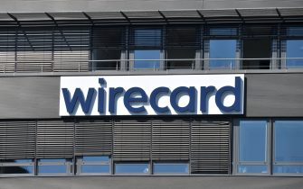 """The company logo is seen at the headquarters of German payments provider Wirecard in Aschheim near Munich, southern Germany, on June 24, 2020. - In what could be one of the biggest financial frauds of recent years, German payments provider Wirecard admitted 1.9 billion euros that auditors say are missing from its accounts likely """"do not exist"""". (Photo by Christof STACHE / AFP) (Photo by CHRISTOF STACHE/AFP via Getty Images)"""