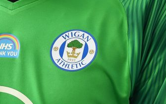 WIGAN, ENGLAND - JUNE 27: A detailed view of a 'Thank You NHS' logo on the shirt of a Wigan Athletic player during the Sky Bet Championship match between Wigan Athletic and Blackburn Rovers at DW Stadium on June 27, 2020 in Wigan, England. (Photo by Nathan Stirk/Getty Images)