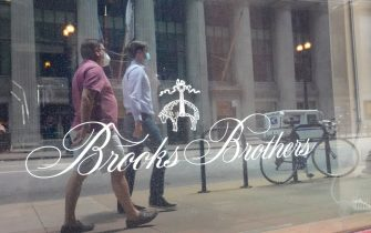 CHICAGO, ILLINOIS - JULY 08: The Brooks Brothers logo is painted on the window of a shuttered store in the financial district on July 08, 2020 in Chicago, Illinois. The retailer which was founded in 1818 and currently has more than 500 stores worldwide filed for bankruptcy protection today.  (Photo by Scott Olson/Getty Images)
