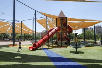 An Israeli girl walks past a playhouse in the municipal park of the northern Israeli city of Afula on July 14, 2019. - Afula will end a selective closure at one of its parks that Arab citizens said was a racist policy meant to keep them out after a court decision on July 14. Afula had decided to keep the park open only to its residents during the summer school holiday, saying that as the facility was funded from municipal funds its residents should be prioritised. Israeli Arab rights group Adalah filed a lawsuit overturning the ban, saying that the move was aimed at keeping out Arab residents of nearby towns and the Arab city of Nazareth. (Photo by AHMAD GHARABLI / AFP)        (Photo credit should read AHMAD GHARABLI/AFP via Getty Images)
