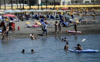 People cool off at Ostia seaside in the outskirts of Rome on August 01 2020 as Italy is in the grip of a heat wave. (Photo by Filippo MONTEFORTE / AFP) (Photo by FILIPPO MONTEFORTE/AFP via Getty Images)
