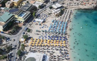 LAMPEDUSA, ITALY - AUGUST 04: Aerial view of a beach crowded with tourists in Lampedusa destination for tourists in the crystal clear waters of the Sicilian island on August 04, 2020 in Lampedusa, Italy. The Italian island has reportedly run out of room to quarantine migrants, as is required as part of Italy's anti-coronavirus measures.  (Photo by Fabrizio Villa/Getty Images)