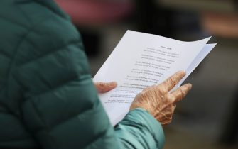 STOCKHOLM, SWEDEN - MAY 21: A woman reads a psalm from a disposable paper instead from a psalm book as she takes part in the Ascension Day Church Service at Gustav Vasa Church on May 21, 2020 in Stockholm, Sweden. Sweden, a country of about 10 million people, has maintained more of an open society as it grappled with the coronavirus pandemic. It is one of several European countries observing the Ascension Day public holiday on Thursday. (Photo by Linnea Rheborg/Getty Images)