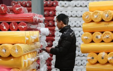 This photo taken on January 1, 2020 shows an employee working at a textile factory in Hangzhou in China's eastern Zhejiang province. (Photo by STR / AFP) / China OUT (Photo by STR/AFP via Getty Images)