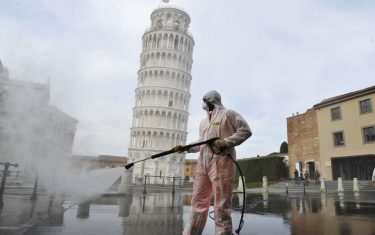 PISA, ITALY - MARCH 17:  A worker carries out sanitation operations for the Coronavirus emergency in Piazza dei Miracoli near to the Tower of Pisa in a deserted town on March 17, 2020 in Pisa, Italy. The sanitization service is carried out by four teams in all the districts of the city of Pisa, to sanitize the squares, streets, public areas, sidewalks, surfaces exposed to the contact of large flows of people. Italian government has imposed unprecedented restrictions on its 60 million people as it expanded its emergency Coronavirus (Covid-19) lockdown nationwide. The number of confirmed Covid-19 cases in Italy has passed 31,500 with the death toll rising to 2503.  (Photo by Laura Lezza/Getty Images)