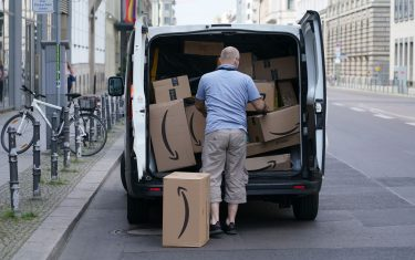 BERLIN, GERMANY - JUNE 18: A courier unloads Amazon packages during a delivery on June 18, 2020 in Berlin, Germany. Amazon has expanded rapidly in Germany and now has at least 13 Amazon warehouses nationwide.  (Photo by Sean Gallup/Getty Images)