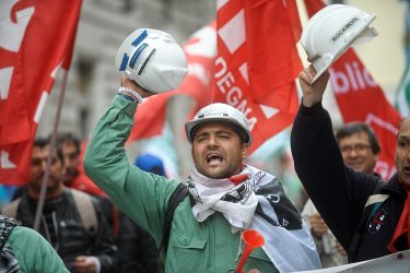 ROME, ITALY - APRIL 13:  Demonstrators and workers belonging to Italian trade unions protest in the streets against the pension reform launched by the government of Mario Monti on April 13, 2012 in Rome, Italy.  The pension reform launched by the government, increasing the retirement age to 66 years, threatens to leave over 65 thousand workers without retirement pay and without any income, according to official estimates provided by the Social Security (INPS).  (Photo by Giorgio Cosulich/Getty Images)