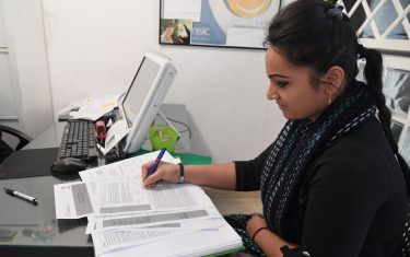 A woman fills an application for Italy's new Citizen's Income (Reddito di Cittadinanza) at a tax service center (Centro di assistenza fiscale, CAF) in Rome on March 6, 2019. - Italys governing Five Star Movement (M5S) launched on March 6 its flagship Citizens' Income scheme, with those elligible starting to send applications to access the benefit, in a first round which will last until March 31st. The scheme is open to low earners and jobseekers with a household income of below 9,360 euros per year who sign a form declaring themselves immediately available for work. (Photo by Tiziana FABI / AFP)        (Photo credit should read TIZIANA FABI/AFP via Getty Images)