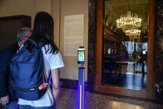 A staff member measures the temperature to visitor before she entries after reopening of the Pinacoteca di Brera after the lockdown due to the Coronavirus Covid-19 pandemic in Milan, Italy, 09 June 2020.  Ansa/Matteo Corner