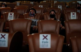 epa08457635 People wear masks and observe the precautionary coronavirus measures in a staged visit to a reopened cinema in Bangkok, Thailand, 01 June 2020. Countries around the world, are gradually easing COVID-19 lockdown restrictions in an effort to restart their economy and help people go back to their daily routines after the outbreak of coronavirus pandemic.  EPA/RUNGROJ YONGRIT