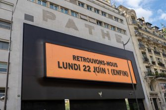 """PARIS, FRANCE - JUNE 11: General view of a Pathe cinema which displays the message """"Retrouvons-nous Lundi 22 Juin !"""" (""""Let's meet on Monday June 22nd""""), as it will re-open on June 22nd 2020 after several weeks of being closed since the national lockdown due to the covid-19 coronavirus outbreak, seen on June 11, 2020 in Paris, France. (Photo by Edward Berthelot/Getty Images)"""