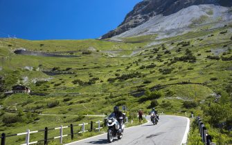 ITALY - JULY 12:  Motorcycles and walker on Stelvio Pass, Passo dello Stelvio, Stilfser Joch, on route Trafoi to Bormio, the Alps, Northern Italy (Photo by Tim Graham/Getty Images)