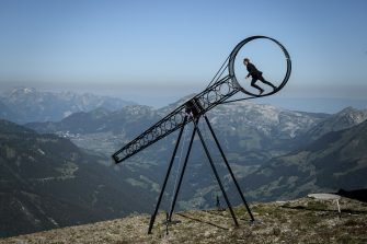 Swiss acrobat Ramon Kathriner performs with the Wheel Of The Death during the Glacier 3000 Air show an event marking the reopening of the Alpine facilities on June 23, 2020 above Les Diablerets following the lockdown due to the COVID-19 outbreak, caused by the novel coronavirus. (Photo by Fabrice COFFRINI / AFP) (Photo by FABRICE COFFRINI/AFP via Getty Images)