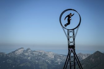 """Swiss acrobat Ramon Kathriner performs with the Wheel Of The Death during the """"Glacier 3000"""" Air show, an event marking the reopening of the Alpine facilities on June 23, 2020 above Les Diablerets following the lockdown due to the COVID-19 outbreak, caused by the novel coronavirus. (Photo by Fabrice COFFRINI / AFP) (Photo by FABRICE COFFRINI/AFP via Getty Images)"""