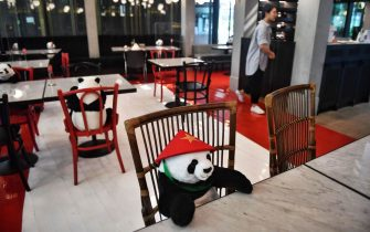 Stuffed toy pandas are used to enforce social distancing as a preventive measure against the spread of the COVID-19 novel coronavirus at the Maison Saigon Saigon restaurant in Bangkok on May 13, 2020. (Photo by Lillian SUWANRUMPHA / AFP) (Photo by LILLIAN SUWANRUMPHA/AFP via Getty Images)