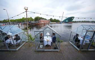 AMSTERDAM, NETHERLANDS - JUNE 03: A general view as customers enjoy the unique set up at Mediamatic ETEN, a restaurant with so-called, Quarantine Greenhouses, as lockdown further eases on June 03, 2020 in UNSPECIFIED, Netherlands. The country was less restrictive in its lockdown measures than neighboring European countries. Schools have partly reopened to teach small groups of pupils and more businesses, including hairdressers, are allowed to resume operation under government set regulations. (Photo by Dean Mouhtaropoulos/Getty Images)