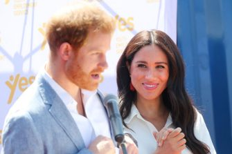 JOHANNESBURG, SOUTH AFRICA - OCTOBER 02: Meghan, Duchess of Sussex looks on as Prince Harry, Duke of Sussex speaks during a visit a township to learn about Youth Employment Services on October 02, 2019 in Johannesburg, South Africa.  (Photo by Chris Jackson/Getty Images)