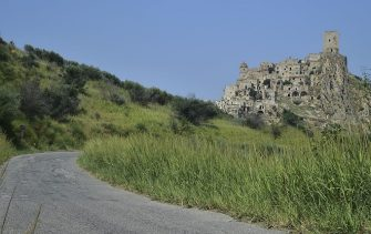 """A picture taken on August 8, 2015 shows the small town of Craco, near Potenza. Due to a landslide, the inhabitants of the town of Craco were evacuated in 1963 to a valley in a locality called Craco Peschiera, by the 1980s the city was completely abandoned. Because of its unique landscape, Craco has been the set of many movie such as """"Quantum of Solace"""" or """"The Passion of The Christ"""".  AFP PHOTO / GIUSEPPE CACACE        (Photo credit should read GIUSEPPE CACACE/AFP via Getty Images)"""