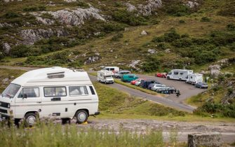 ULLAPOOL, SCOTLAND - JULY 28: Car parks and beauty spots along the A838 are busy as tourists take to the North Coast 500 route on July 29, 2020 in Ullapool, Scotland. Scotland has recently lifted the ban on holiday accommodation and up to 15 people can meet outdoors that was put in place to curb the spread of Coronavirus. North Scotland has seen an influx of camper vans and tourists. (Photo by Paul Campbell/Getty Images)