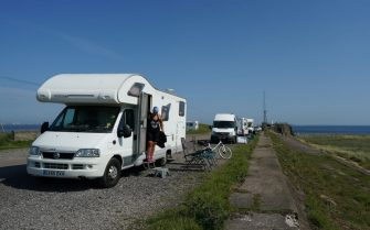 REDCAR, UNITED KINGDOM - JUNE 24: Camper vans park up at South Gare near Redcar as people enjoy the hot weather on June 24, 2020 in Redcar, United Kingdom. A summer heatwave is expected across the country this week with weather warnings issued in some places for thunderstorms. (Photo by Ian Forsyth/Getty Images)