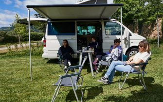 GARGANTILLA DE LOZOYA, SPAIN - JUNE 13: A group of friends enjoys a weekend with their motorhome at the Monte Holiday campsite on June 13, 2020 in Gargantilla de Lozoya y Pinilla de Buitrago, Spain. The campsite, which had to close during the country's months-long coronavirus lockdown, has a capacity for 1,200 people and is completely booked for every weekend from mid-July through August. They have an average of 4,000 daily visits on the web and are seeing a large increase in people who come with motorhomes. (Photo by Carlos Alvarez/Getty Images)