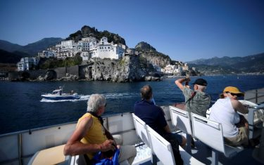 A view taken on July 2, 2020 shows tourist sail off Amalfi on the Amalfi coast in southern Italy. - With its white and multicoloured houses perched on the mountainside about the crystalline waters of the Mediterranean, Italy's Amalfi coast is suffering from this year's lack of US tourists. (Photo by Filippo MONTEFORTE / AFP) (Photo by FILIPPO MONTEFORTE/AFP via Getty Images)