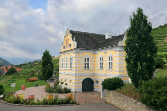 DURNSTEIN, AUSTRIA - JULY 27: Domäne Wachau's Baroque-style landmark chateau, which was completed in 1719, is seen nestled between the award-winning winery's vineyards on July 27, 2019 in the Wachau Valley village of Dürnstein, Austria. Domäne Wachau, the biggest winery in the region with a history going back at least 300 years, was recently chosen as #19 on the 2019 list of the Worldâ  s Best Vineyards. (Photo by David Silverman/Getty Images)