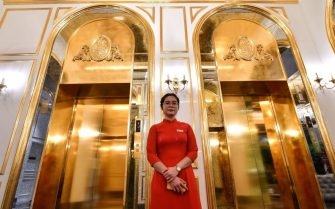 A staff member stands near the lifts in the lobby of the newly-inaugurated Dolce Hanoi Golden Lake hotel, the world's first gold-plated hotel, in Hanoi on July 2, 2020. (Photo by Manan VATSYAYANA / AFP) (Photo by MANAN VATSYAYANA/AFP via Getty Images)