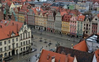 WROCLAW, POLAND - MARCH 09: Buildings stand on Market Square on March 9, 2019 in Wroclaw, Poland. Wroclaw, capital of Silesia, was under a variety of rulers throughout its over 1,000 year history, including the kingdoms of Bohemia, Poland, Prussia, Germany and the Hapsburgs. Before 1945 it was called Breslau and was the third largest city in Germany. Heavily damaged in the final months of World War II, its historic city center has since been restored. Today Wroclaw is a popular tourist destination.  (Photo by Sean Gallup/Getty Images)