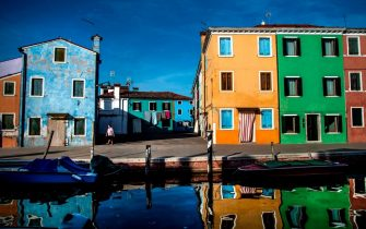 A view shows houses and a canal in Burano, the most colorful island in the Venice lagoon, on September 11, 2020. (Photo by Tiziana FABI / AFP) (Photo by TIZIANA FABI/AFP via Getty Images)